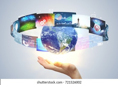 Hand holding globe with abstract media interface on light background. Innovation concept. 3D Rendering