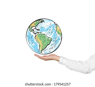 A hand holding a globe (North and South Americas)