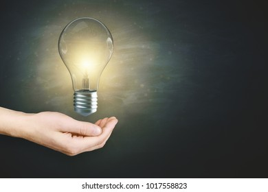 Hand holding glowing lamp. Idea and innovation. 3D Rendering