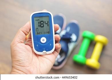 Hand holding glucose meter.High blood sugar.