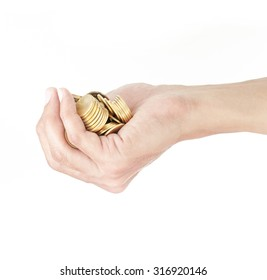 Hand holding gold coin on white background