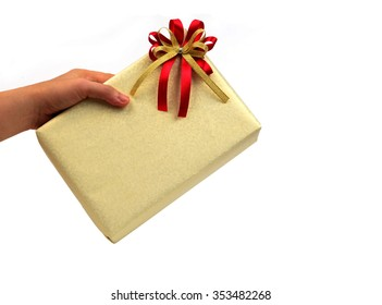 Hand is holding a golden gift box.