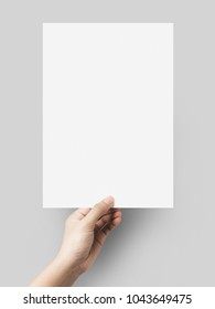 Hand holding gray color paper blank