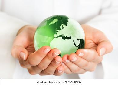 Hand holding green glass globe