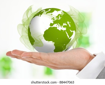 Hand holding a green globe