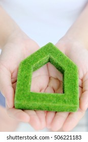 hand holding green house icon concept