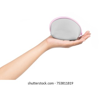 Hand holding grey coin purse Isolated on white background