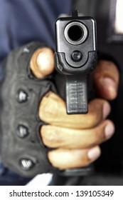 Hand is holding a gun