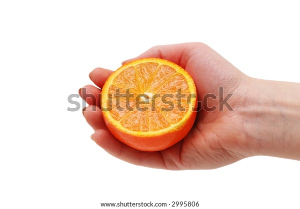 Hand holding half cut orange  isolated on white