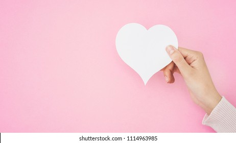 Hand holding heart shape card