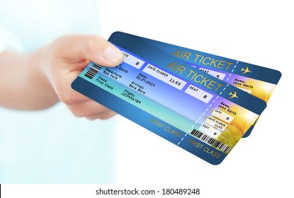 hand holding holiday airline boarding pass tickets