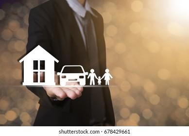 hand holding home car family. concept assurance health-care insurance.