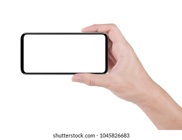 Hand holding horizontal the black smartphone with white screen, isolated on white background with clipping path