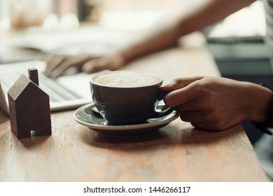 hand holding hot coffee and relax after finish job