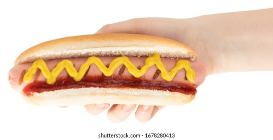 Hand holding hot dog with mustard isolated on white background. Ð¡lipping path.