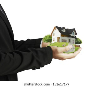 hand holding house architectural model