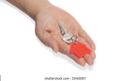 Hand holding house key