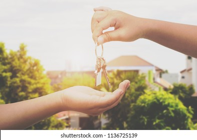Hand holding house key on new home background,real estate agent,Mortgage concept