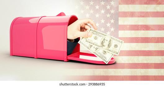 Hand holding hundred dollar bills against usa flag in grunge effect