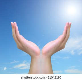 hand holding isolated on blue sky