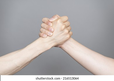 Hand holding hand isolated over gray background - Friendship, Shaking hands Business, Congratulation
