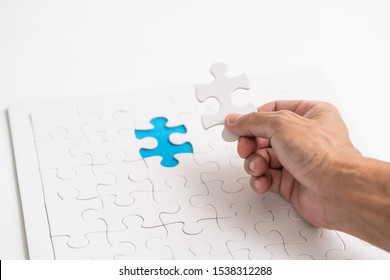 Hand holding jigsaw piece. for business concept