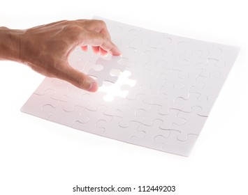 hand holding jigsaw puzzle piece