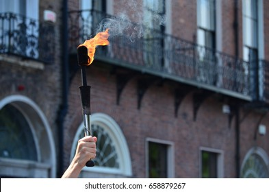 Hand holding a Juggling Fire Torch
