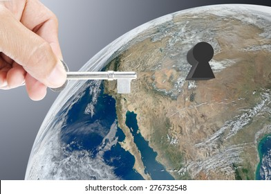 Hand holding key on earth background , Elements of image are furnished by NASA