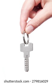 Hand holding key on white background