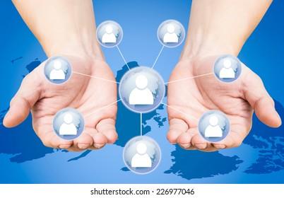 Hand holding a key social media