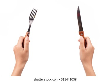 hand holding knife and fork isolated on white background