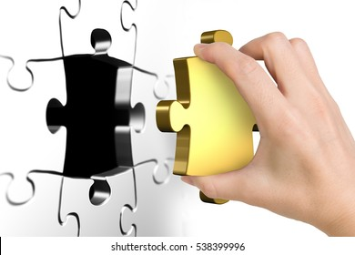 Hand holding last missing golden puzzle piece, isolated on white.