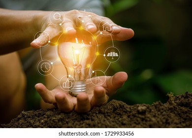 hand holding light bulb against nature, icons energy sources for renewable, - Shutterstock ID 1729933456