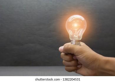Hand holding light bulb Concept of startup