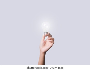 hand holding light bulb, concept of new technology ideas with innovation and creativity.