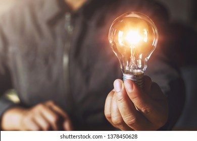 hand holding light bulb. idea concept with innovation and inspiration