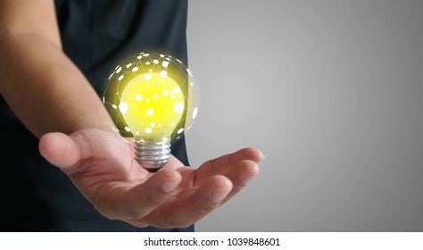 Hand holding light bulb. New idea concept, innovation and creativity