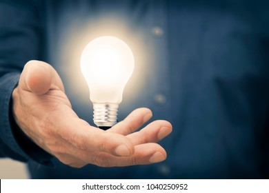hand holding the light bulb on, concept of idea and creativity