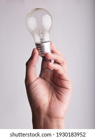 hand holding light bulb with white backgroubd