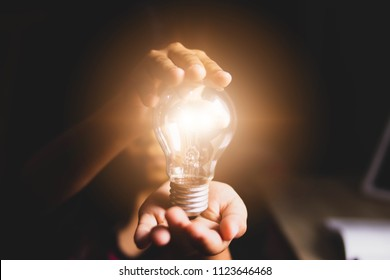Hand holding light bulbs, Concept new ideas for your study or thinking creativity, Copy space. Creativity and innovative are keys to success.