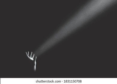 hand holding light rays in the darkness, hope concept