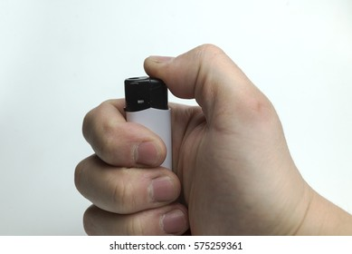 Hand holding a lighter on a white background.