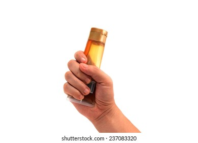 hand holding Lotion bottle from below isolated on white