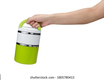 Hand holding lunch box isolated on white background with clipping path
