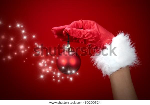 Hand holding magic Christmas ball