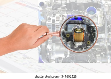 Hand holding magnifying glass isolated on Oil filter car engine check periodicaly. This has clipping path.