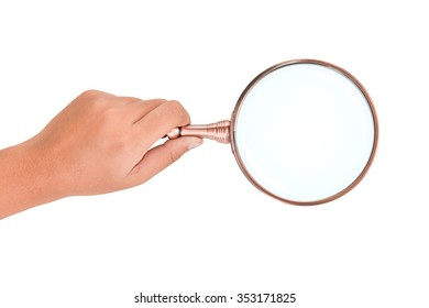 Hand holding magnifying glass isolated on white background. This has clipping path.