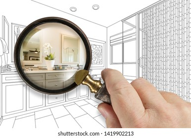 Hand Holding Magnifying Glass Revealing Custom Bathroom Design Drawing and Photo Combination.