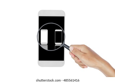 Hand holding magnifying glass with smartphone isolated on white background